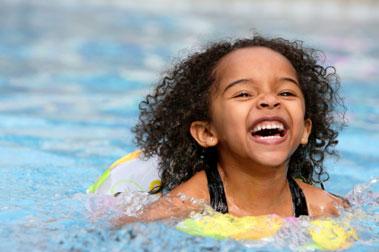 Young girl swimming in pool
